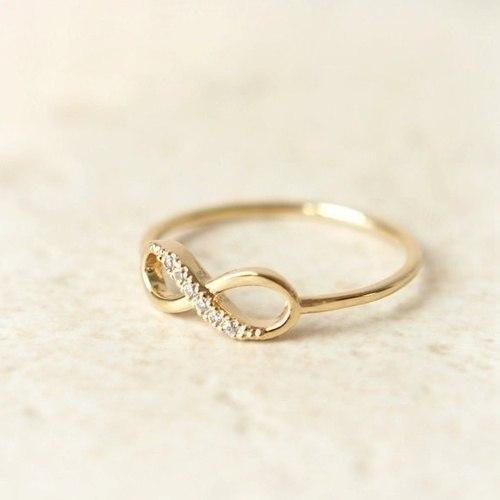 купить золотое кольцо со знаком бесконечность